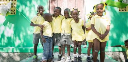 Young school children smiling