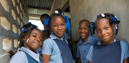4 school kids smiling