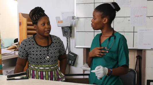 Dr. Mirielle Bien-Aimé speaks with a nurse in the SBHF Emergency Department