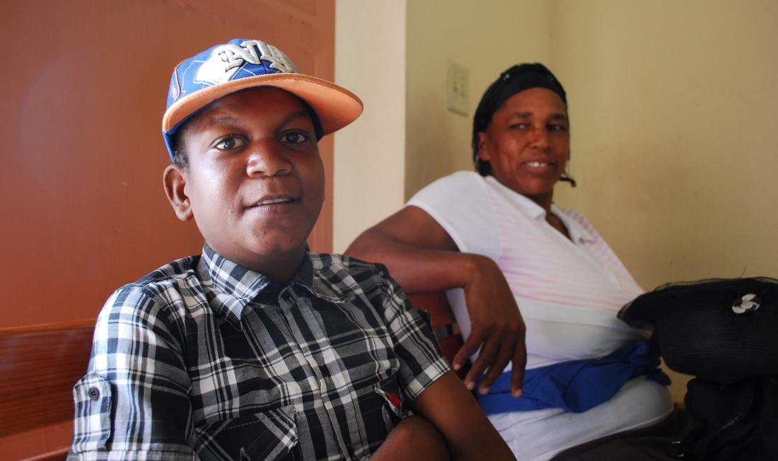Calebe Terlo and his mother wait at the Villa Clinic
