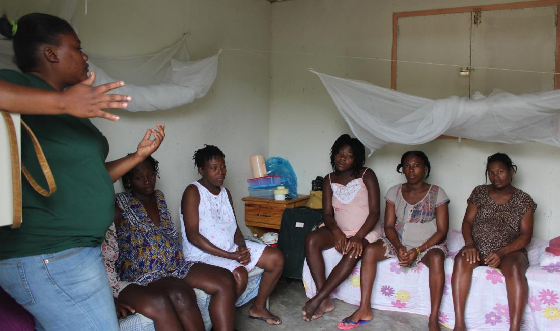 Rose Andre conducts an education session at Kay Fanm Ansent