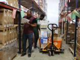 Employees fill hospital supply orders at the SBHF warehouse