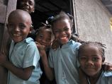 Four school children smiling