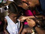 5 year old Woodlande gets an exam at a mobile clinic stop