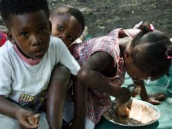 3 young children eating
