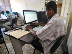 St. Boniface employee working at a computer