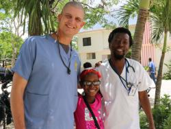 Dr. Ward, Dr Desiree and their patient Tika on discharge day healthy again