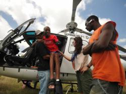 A man who suffered from a spinal cord injury being carried off of a helicopter