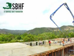 Crane over the foundation of maternal health center
