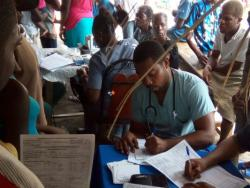 Patients filling out paperwork in mobile clinic