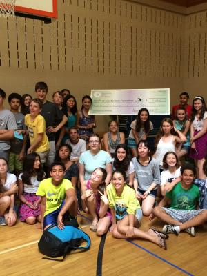 Students at Lincoln School holding giant check